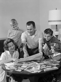 1960s Happy Family Father Mother Two Sons One Daughter Planning Trip Looking at Maps Photographic Print by H. Armstrong Roberts