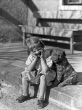 Little Girl Sitting on Porch Stoop Funny Expression Hands Up to Her Face Beside Her Dog Photographie par H. Armstrong Roberts