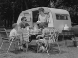 Family Camping Eating Meal Beside RV Camper Photographic Print by H. Armstrong Roberts