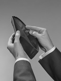 Male Hands Opening an Empty Wallet Photographic Print by H. Armstrong Roberts
