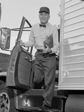 Delivery Man Stepping Out of Truck Holding Clipboard Photographic Print by H. Armstrong Roberts