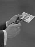 Male Hands with Scissors Cutting Dollar Bill in Half Photographic Print by H. Armstrong Roberts