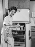 1950s Smiling Woman Housewife Putting Stick of Butter into Electric Refrigerator in Kitchen Photographic Print by H. Armstrong Roberts