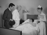 Doctor Nurse Husband Talking with Female Patient in Hospital Bed Photographic Print by H. Armstrong Roberts