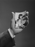Male Hand Holding Family Photo Photographic Print by H. Armstrong Roberts
