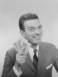 Smiling Man Holding a Fistful of Money Fake Bills Photographic Print by H. Armstrong Roberts