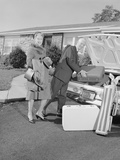 Senior Man Woman Husband Wife Packing Trunk with Luggage Photographic Print by H. Armstrong Roberts