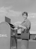 Smiling Woman Dropping Letters in Postal Mail Box Photographic Print by H. Armstrong Roberts