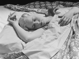 Sleeping Blond Woman Hand over Head Asleep Photographic Print by H. Armstrong Roberts