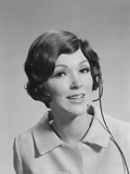 Smiling Brunette Woman Wearing Telephone Head Set Photographic Print by H. Armstrong Roberts