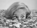 1960s Bug-Eyed Surprised Woman Buried in Coins Money Symbolic Photographic Print by H. Armstrong Roberts