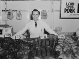 Portrait Smiling Man Butcher Grocer at Meat Counter Photographie par H. Armstrong Roberts