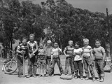 1950s Line-Up of 9 Boys in Tee Shirts with Bats and Mitts Facing Camera Photographic Print by D. Corson