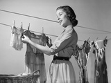 1950s Smiling Woman Housewife Hanging Wash Child Dress on Clothesline to Dry Photographic Print by H. Armstrong Roberts