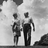 Mature Couple Walking Holding Hands Photographic Print by H. Armstrong Roberts