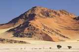 Towering Sandstone Mountains and Dunes in the Ancient Namib Desert Near Sesriem Photographic Print by Lee Frost
