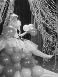 Woman Dressed in Harlequin Costume Sitting on Stack of Balloons Photographic Print by H. Armstrong Roberts
