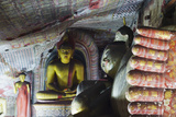 Buddha Statues in Cave 2 Photographic Print by Christian Kober