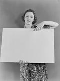 Woman Holding Blank Poster Sign Hand Pointing from Top Photographic Print by H. Armstrong Roberts