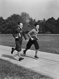 Two Smiling Boys Running Carrying School Books Photographic Print by H. Armstrong Roberts