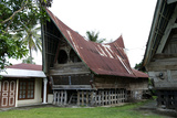 Batak Toba Tribal Rural Village Houses with Contemporary Extensions on Samosir Island in Lake Toba Photographic Print by Annie Owen