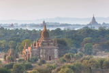 View over the Temples of Bagan Swathed in Early Morning Mist Photographie par Lee Frost