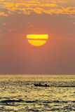 Fishing Boat and Sunset Off Playa Guiones Surf Beach Photographic Print by Rob Francis