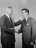 Older and Younger Business Men Shaking Hands Photographic Print by H. Armstrong Roberts