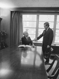 Two Men One Seated Shaking Hands Long Wooden Conference Table Photographic Print by H. Armstrong Roberts