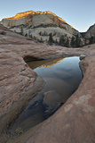 Pool in Slick Rock Reflecting First Light on a Sandstone Hill Photographic Print by James Hager