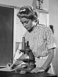 Teen Girl Writing Notes Working with Microscope in Science Classroom Photographic Print by H. Armstrong Roberts