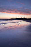 Looking across Embleton Bay at Sunrise Towards the Silhouetted Ruins of Dunstanburgh Castle Photographic Print by Lee Frost