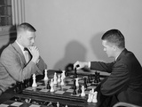 Two Men Playing Chess Game Photographic Print by H. Armstrong Roberts