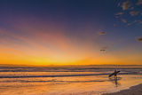 Sunset and Surfer at Playa Guiones Beach Photographic Print by Rob Francis