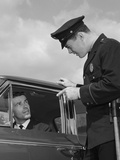 Police Officer Warning Motorist Pointing Finger at Driver Photographic Print by H. Armstrong Roberts