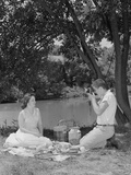 Teenage Couple Picnic Boy Taking Photograph of Girl Outdoors Photographic Print by H. Armstrong Roberts