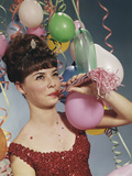 Woman Blowing New Years Party Noisemaker Photographic Print by H. Armstrong Roberts