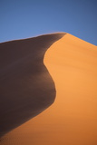 The Orange Sand and Snaking Ridge of Elim Dune Against Blue Sky Photographic Print by Lee Frost