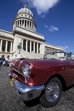 Red Vintage American Car Parked Opposite the Capitolio Photographic Print by Lee Frost