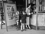 Mother and 2 Children Buying Tickets to Movie Matinee Boy Wearing Cowboy Costume Photographic Print by H. Armstrong Roberts