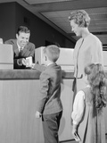 Mother Two Children Boy Handing Banking Deposit to Male Bank Teller Photographic Print by H. Armstrong Roberts