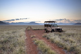 Land Rover Game Vehicle Parked by Sand Road at Sunrise Photographic Print by Lee Frost