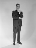 Thoughtful Businessman Standing Holding Hand to Chin Photographic Print by H. Armstrong Roberts