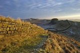 Sunrise and Hadrian's Wall National Trail in Winter Photographic Print by Peter Barritt