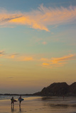 Surfers at Sunset on Playa Guiones Surf Beach Papier Photo par Rob Francis