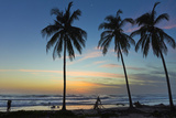 Palm Trees at Sunset on Playa Guiones Surf Beach at Sunset Photographic Print by Rob Francis