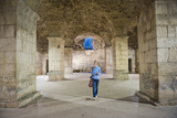 Tourist Exploring the Underground Halls at Diocletian's Palace Photographic Print by Matthew Williams-Ellis