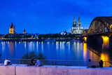 Rhine Bridge and Cathedral of Cologne Above the River Rhine at Night Photographie par Michael Runkel