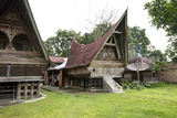 Batak Toba Tribal Rural Village Houses on Samosir Island in Lake Toba Photographic Print by Annie Owen