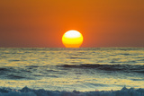 Sun Touching Horizon at Sunset Photographic Print by Rob Francis